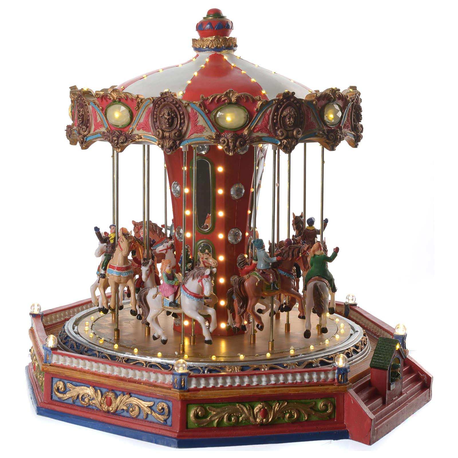 Giostra dei cavalli per villaggio natalizio illuminata in movimento e musica 35x35x35 3