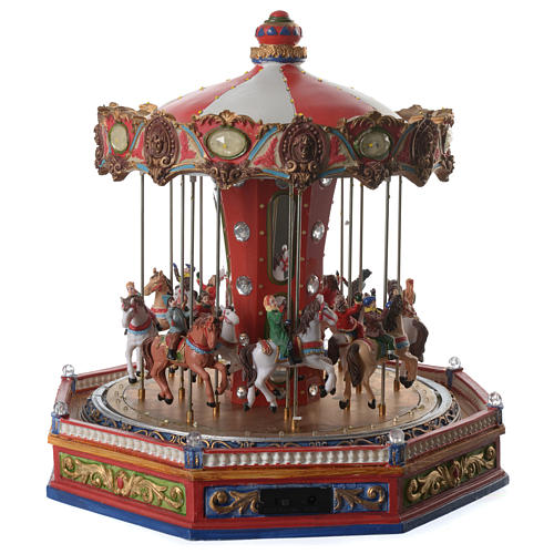 Giostra dei cavalli per villaggio natalizio illuminata in movimento e musica 35x35x35 4