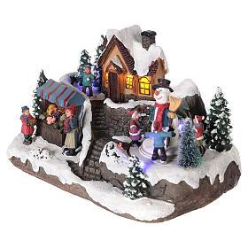 Winterszene Kind mit Tannenbaum 25x15x15cm Licht und Bewegung mit Batterien s3