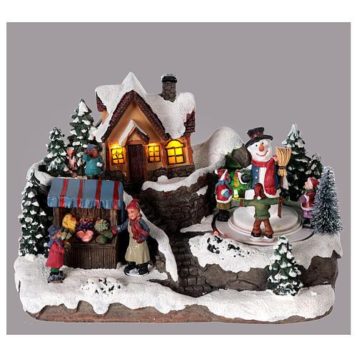 Aldea de navidad niño y hombre de nieve en movimiento iluminado 25x15x15 2