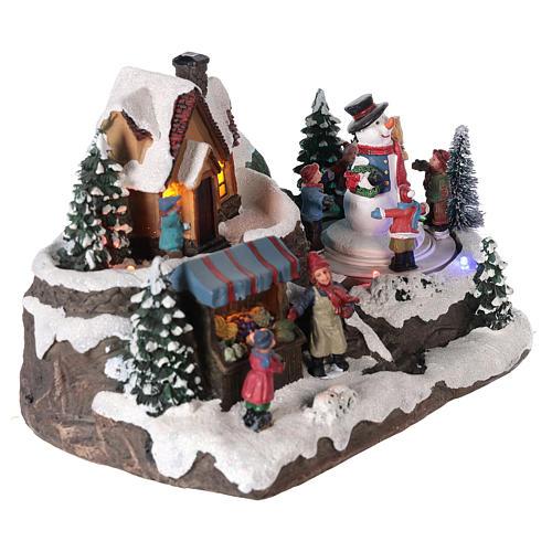 Aldea de navidad niño y hombre de nieve en movimiento iluminado 25x15x15 4