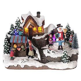 Villages de Noël miniatures: Village de Noël enfant et bonhomme de neige en mouvement éclairé 24x15x15 cm