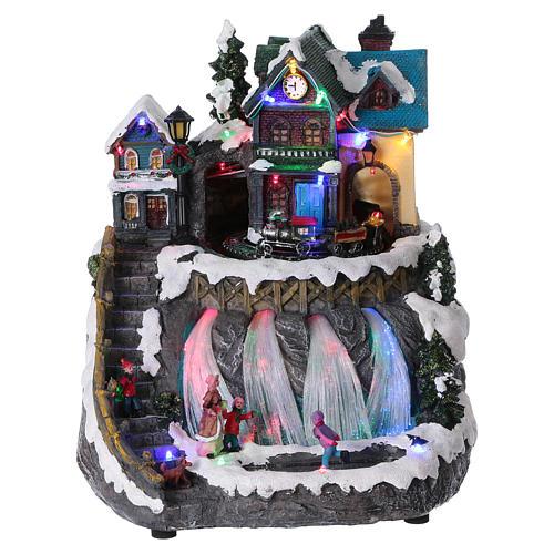 Pueblo de Navidad luces fibra óptica tren musica 30x25x30 cm corriente 1