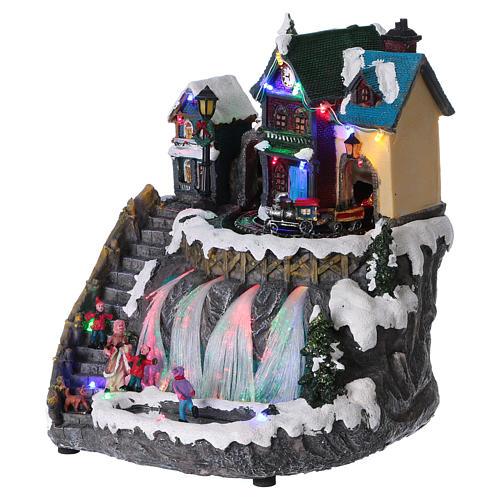 Pueblo de Navidad luces fibra óptica tren musica 30x25x30 cm corriente 3