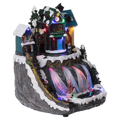 Pueblo de Navidad luces fibra óptica tren musica 30x25x30 cm corriente 4
