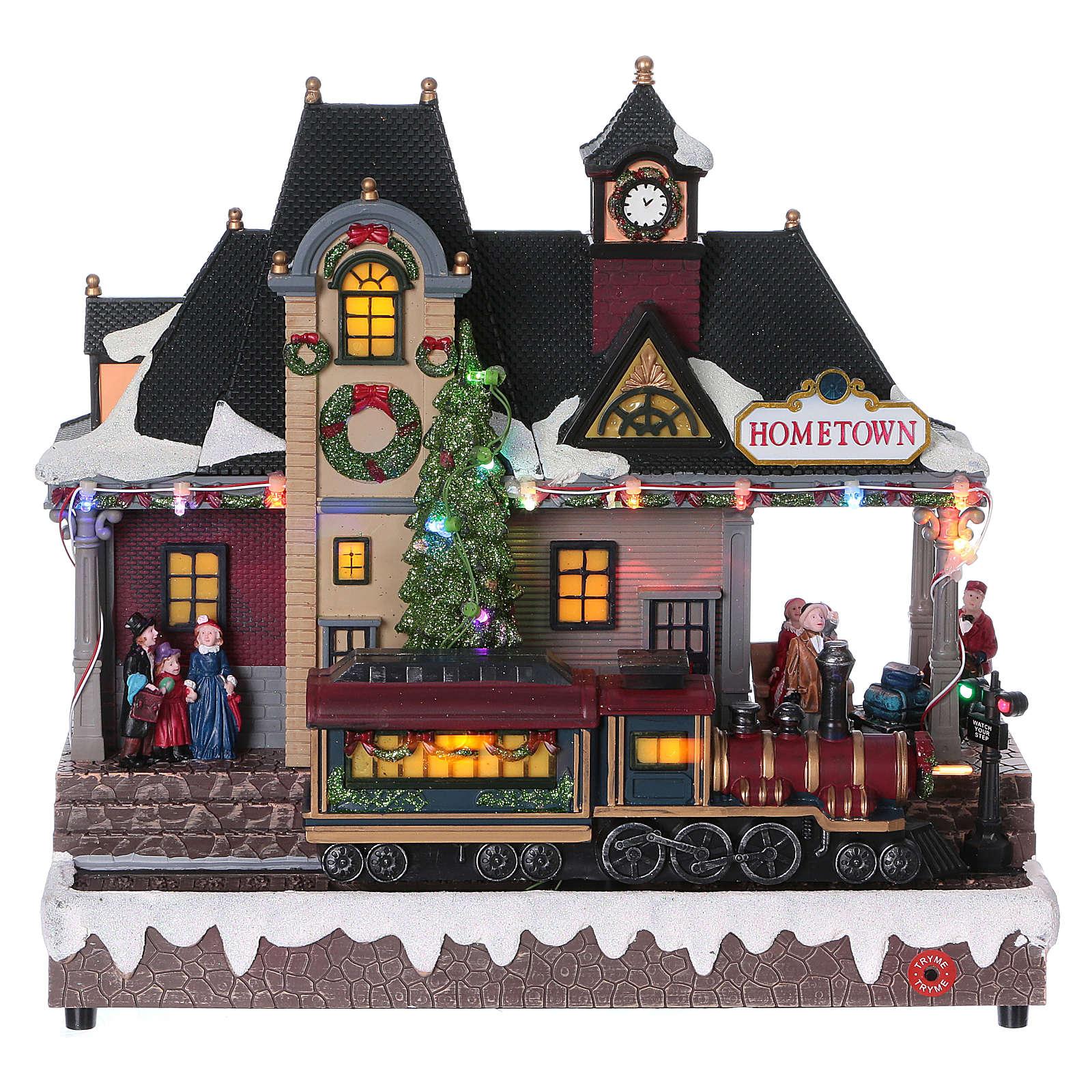 Weihnachtsdorf beleuchteter Bahnhof mit Zug in Bewegung 30x30x15 mit Batterie und Netzanschluss 3
