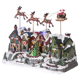 Christmas village with lights and Santa Claus movement 30x35x20 cm s3