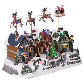 Christmas village with lights and Santa Claus movement 30x35x20 cm s4