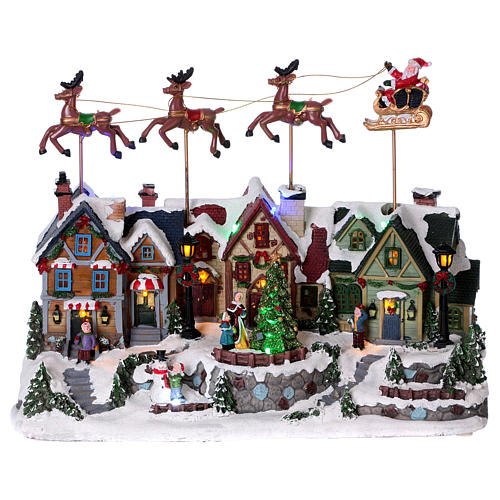 Christmas village with lights and Santa Claus movement 30x35x20 cm 1