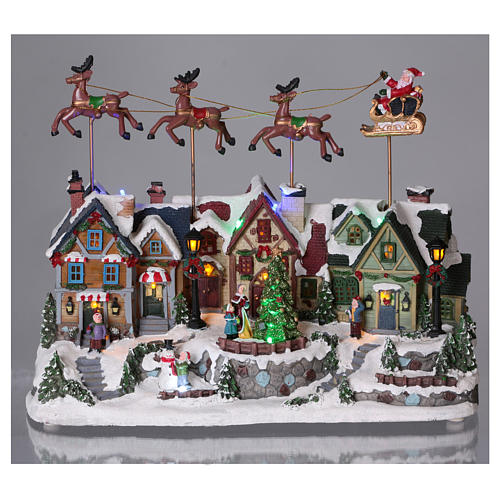 Christmas village with lights and Santa Claus movement 30x35x20 cm 2