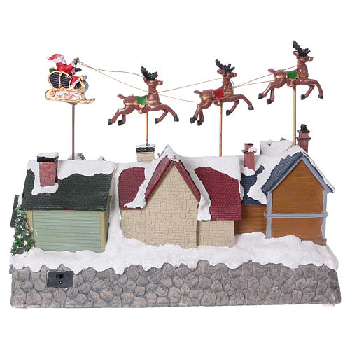 Christmas village with lights and Santa Claus movement 30x35x20 cm 5