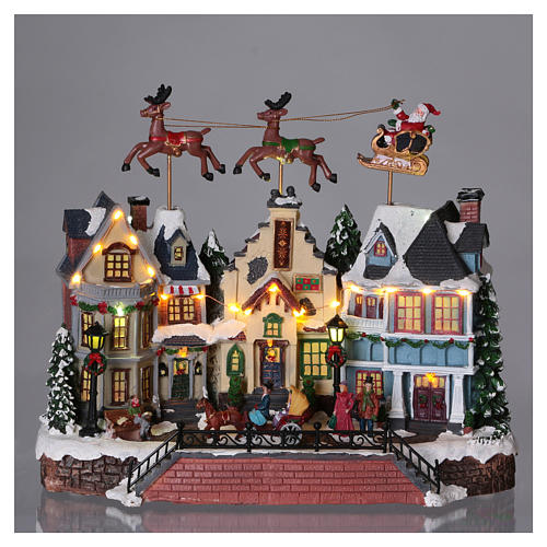 Christmas village with lights and moving Santa Claus with reindeers 30x35x20 cm 2