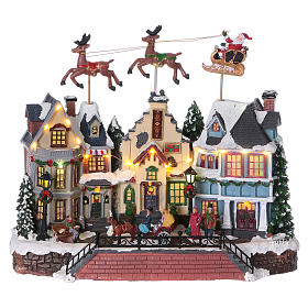 Cenário de Natal Pai Natal renas movimento 30x35x20 cm luzes música corrente s1