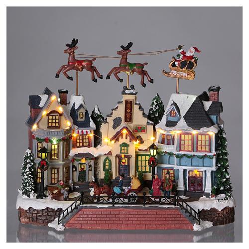 Cenário de Natal Pai Natal renas movimento 30x35x20 cm luzes música corrente 2