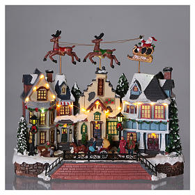 Santa Clause Christmas Village with moving Reindeer 30x35x20 lights music s2