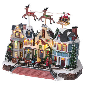 Santa Clause Christmas Village with moving Reindeer 30x35x20 lights music s3