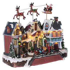 Santa Clause Christmas Village with moving Reindeer 30x35x20 lights music s4