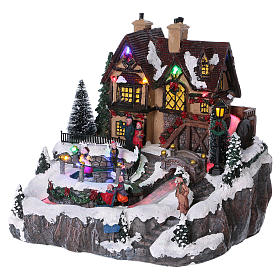 Christmas village with lights and moving ice skaters 25x25x25 cm s3