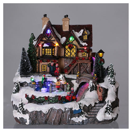 Christmas village with lights and moving ice skaters 25x25x25 cm 2