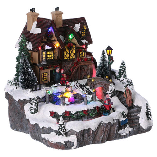 Christmas village with lights and moving ice skaters 25x25x25 cm 4