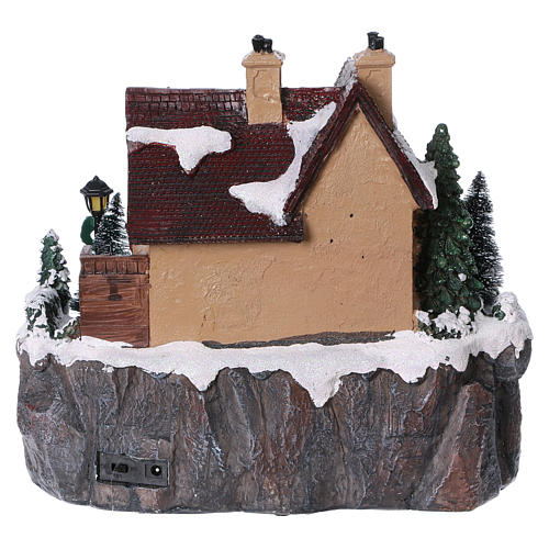 Christmas village with lights and moving ice skaters 25x25x25 cm 5