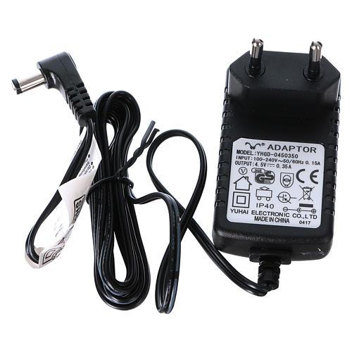 Villaggio Natalizio 25x25x25 cm luci fibra pattinatori movimento corrente batteria 6