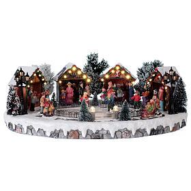 Weihnachtsdorf mit 6 Schlittschuhläufern in Bewegung 20x45x35 mit Beleuchtung und Musik Netzanschluss s1