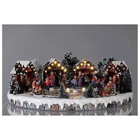 Weihnachtsdorf mit 6 Schlittschuhläufern in Bewegung 20x45x35 mit Beleuchtung und Musik Netzanschluss s2