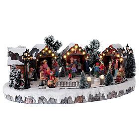 Weihnachtsdorf mit 6 Schlittschuhläufern in Bewegung 20x45x35 mit Beleuchtung und Musik Netzanschluss s4