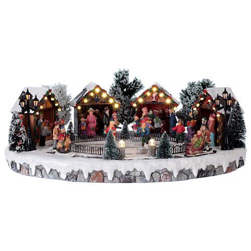 Weihnachtsdorf mit 6 Schlittschuhläufern in Bewegung 20x45x35 mit Beleuchtung und Musik Netzanschluss 1