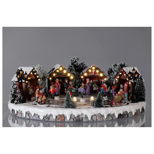 Weihnachtsdorf mit 6 Schlittschuhläufern in Bewegung 20x45x35 mit Beleuchtung und Musik Netzanschluss 2