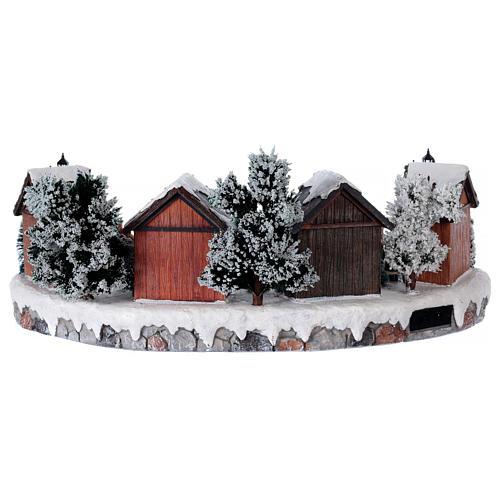 Weihnachtsdorf mit 6 Schlittschuhläufern in Bewegung 20x45x35 mit Beleuchtung und Musik Netzanschluss 5