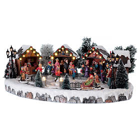 Christmas village with lights and six moving ice skaters 20x45x35 cm s3