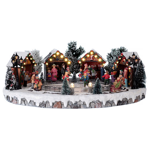 Christmas village with lights and six moving ice skaters 20x45x35 cm 1