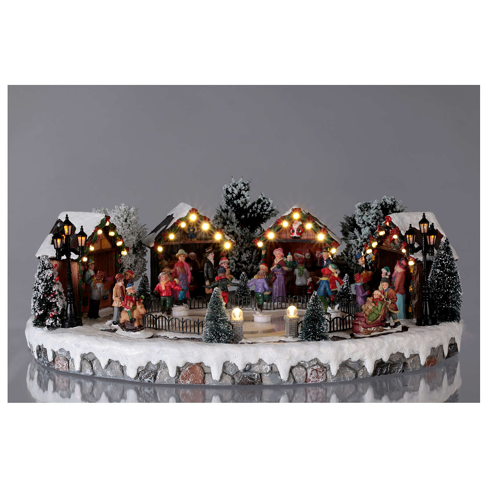 Christmas Village.Christmas Village With Animated Ice Skaters And Music 20x45x35 Cm