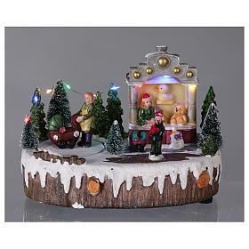Village de Noël 15x25x10 cm lumières musique mouvement poussette s2