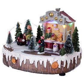Village de Noël 15x25x10 cm lumières musique mouvement poussette s3