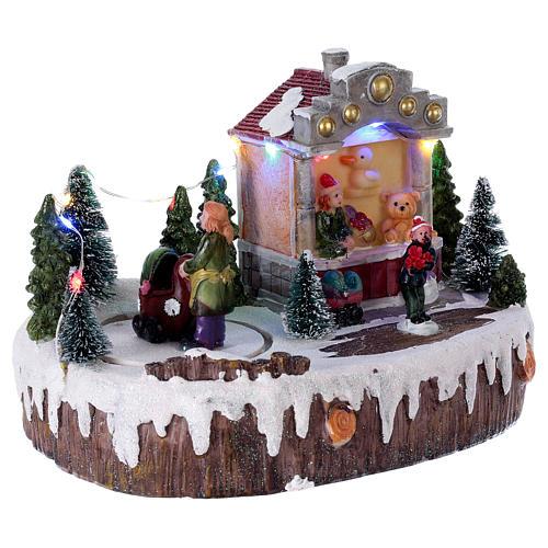 Village de Noël 15x25x10 cm lumières musique mouvement poussette 4