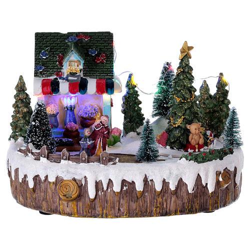 Pueblo de Navidad 15x20x10 cm tienda luces música movimiento árbol 1