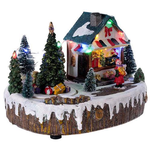 Pueblo de Navidad 15x20x10 cm tienda movimiento árbol luces 4