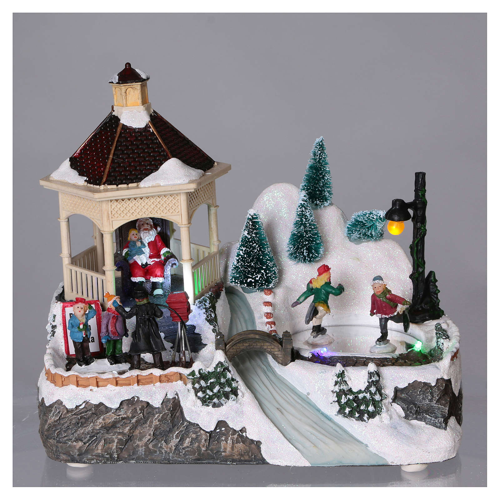 Christmas village with lights, moving ice skaters and Santa Claus 20x25x16 cm 3