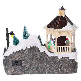 Christmas village with lights, moving ice skaters and Santa Claus 20x25x16 cm s5