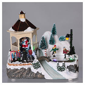 Illuminated Christmas village with animated ice skaters and Santa Claus 20x25x16 cm s2