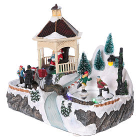 Illuminated Christmas village with animated ice skaters and Santa Claus 20x25x16 cm s3
