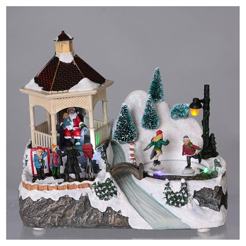 Illuminated Christmas village with animated ice skaters and Santa Claus 20x25x16 cm 2