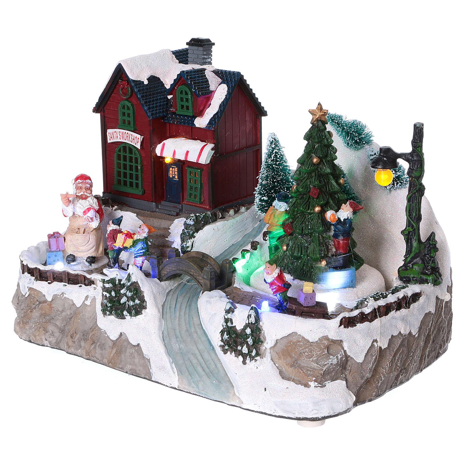 Pueblo Navideño iluminado árbol en movimiento Papá Noel elfos 20x25x16 cm batería corriente 3