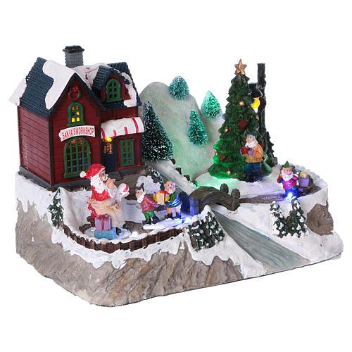Cenário natalino iluminado árvore em movimento Pai Natal elfos 21x25x16  cm pilhas corrente 4