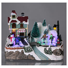 Dekoracja scenka świąteczna podświetlana ruchomi łyżwiarze sklep z zabawkami 20x25x16 cm na baterie zasilacz s2