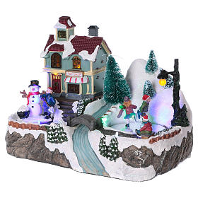 Illuminated Christmas village with animated ice skaters and toy shop 20x25x16 cm s3