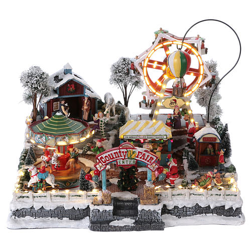 Christmas village 30x45x35 cm with moving fun fair, lights and music 1